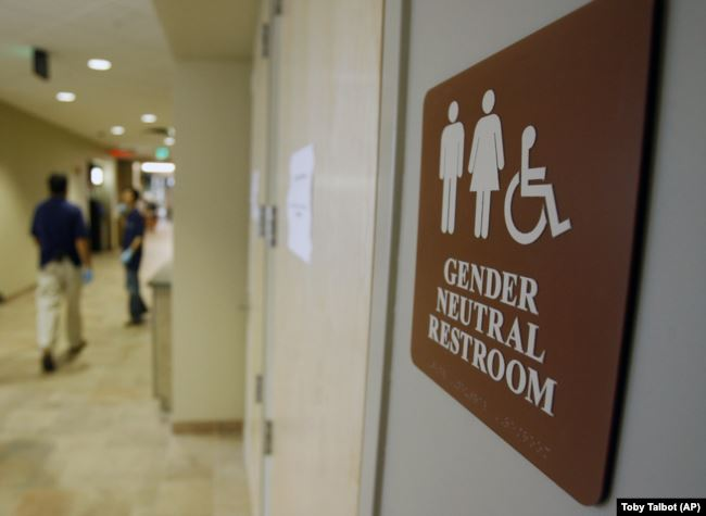 In this August 23, 2007, file photo, a sign marks the entrance to a gender-neutral restroom at the University of Vermont in Burlington, Vermont.