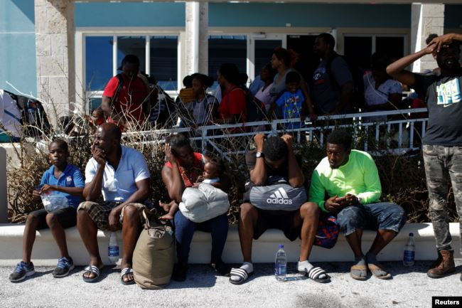 People wait at the Leonard M. Thompson International Airport during an evacuation operation after Hurricane Dorian hit the Abaco Islands in Marsh Harbour, Bahamas, September 6, 2019. REUTERS/Marco Bello