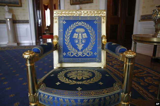 This Sept. 17, 2019, photo shows a restored chair in the Blue Room of the White House.