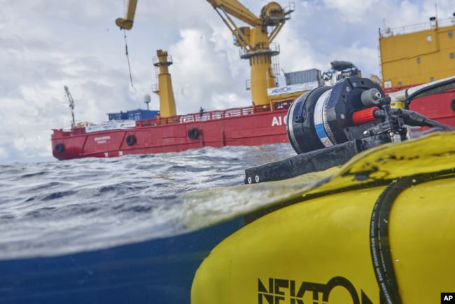 The manned submersible emerges from the water after a dive off the coast of the island of St. Joseph in the Seychelles, Monday April 8, 2019. For more than a month researchers from Nekton, a British-led scientific research group.