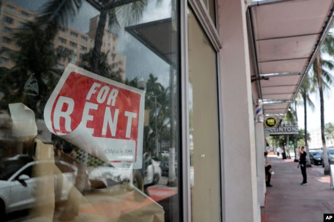 FILE - In this July 13, 2020 file photo, a For Rent sign hangs on a closed shop during the coronavirus pandemic in Miami Beach, Fla.
