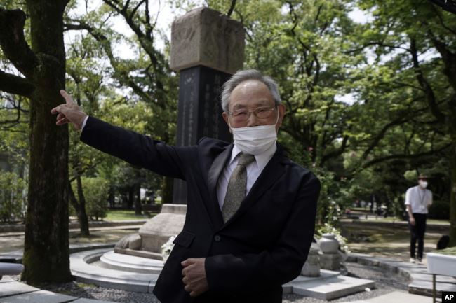 Lee Jong-keun, an atomic bomb survivor, speaks after a memorial service for Korean atomic bomb victims in front of Monument to Korean Victims and Survivors at Hiroshima Peace Memorial Park in Hiroshima, western Japan Wednesday, Aug. 5, 2020. (AP Photo)