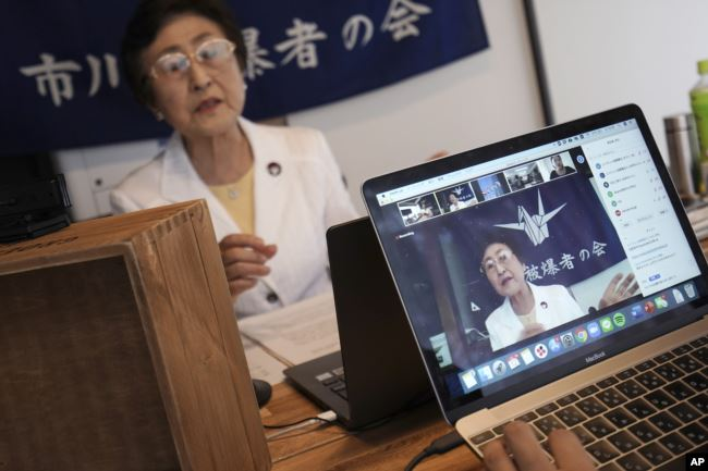Michiko Kodama, assistant secretary-general of the Japan Confederation of A and H Bomb Sufferers' Organizations, narrates her experience on a livestream of 'Kataribe' or story-telling session Sunday, July 12, 2020, in Tokyo. (AP Photo/Eugene Hoshiko)